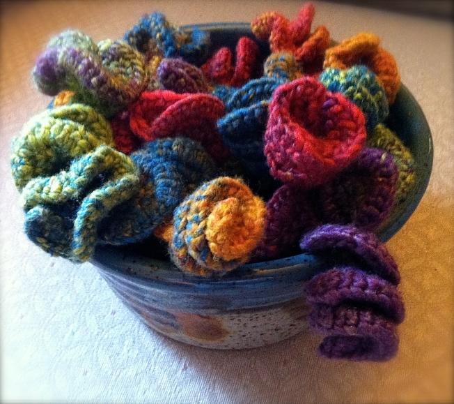 Hyperbolic crochet sculpture in ceramic bowl: Fiber Art Reflections