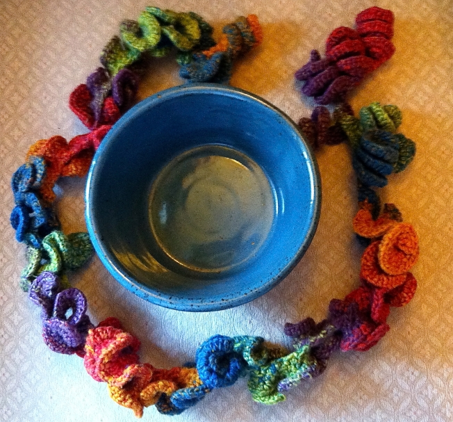 Hyperbolic crochet rope sculpture and ceramic display bowl: Fiber Art Reflections